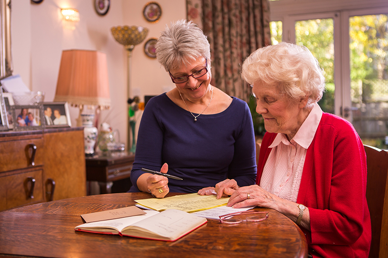 Care manager explaining care rota to client