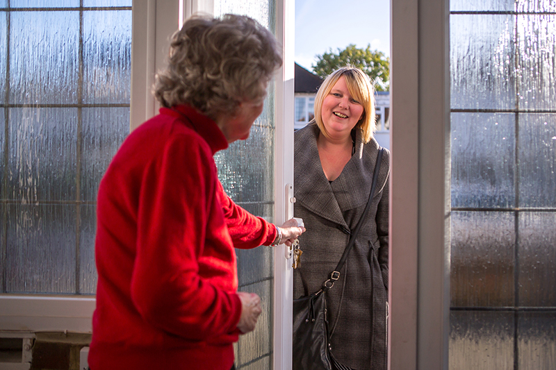 client opening door to carer