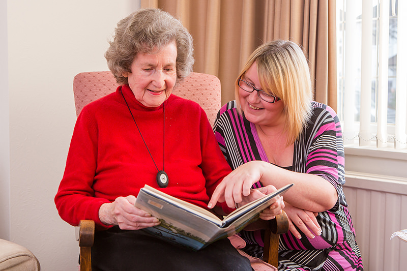 Client carer reading companionship