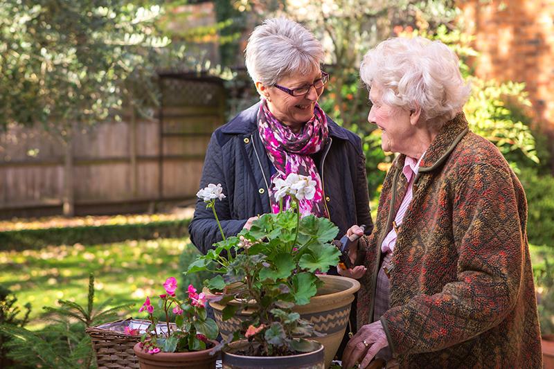 carer client gardening together